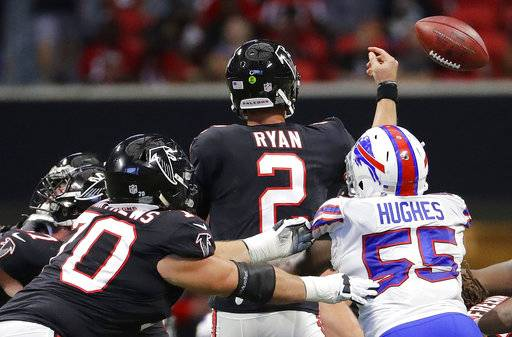 Buffalo Bills defensive end Jerry Hughes (55) hits Atlanta Falcons quarterback Matt Ryan (2) causing Ryan to fumble during the second half of an NFL football game, Sunday, Oct. 1, 2017, in Atlanta. Buffalo Bills cornerback Tre'Davious White picked up the ball and scored a touchdown.