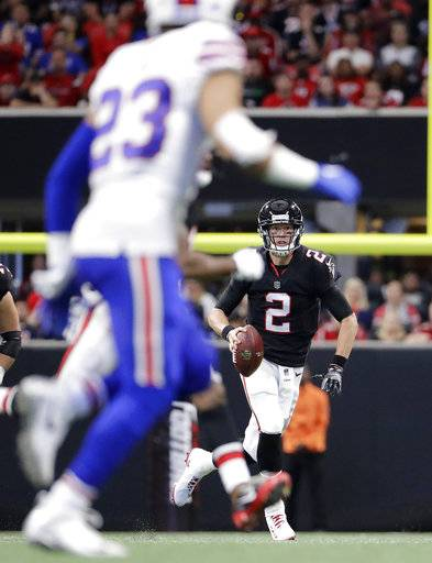 Atlanta Falcons quarterback Matt Ryan (2) runs out of the pocket against the Buffalo Bills during the second half of an NFL football game, Sunday, Oct. 1, 2017, in Atlanta.