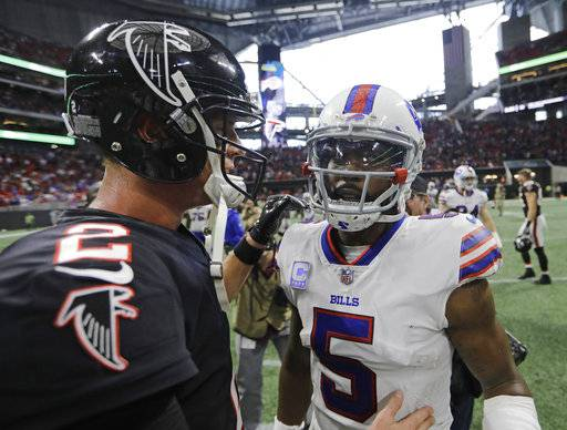 Atlanta Falcons quarterback Matt Ryan speaks with Buffalo Bills quarterback Tyrod Taylor after an NFL football game, Sunday, Oct. 1, 2017, in Atlanta. The Buffalo Bills won 23-17.