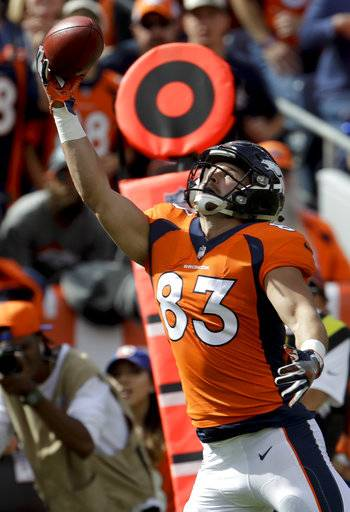 Denver Broncos tight end A.J. Derby catches a touchdown pass during the first half of an NFL football game against the Oakland Raiders Sunday, Oct. 1, 2017, in Denver.