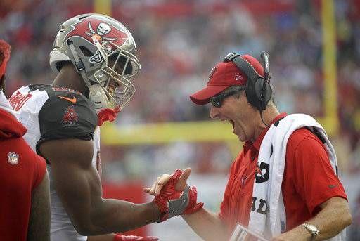 Tampa Bay Buccaneers head coach Dirk Koetter, right, celebrates with tight end O.J. Howard (80) after Howard coaught a 58-yard touchdown pass during the first quarter of an NFL football game against the New York Giants Sunday, Oct. 1, 2017, in Tampa, Fla.