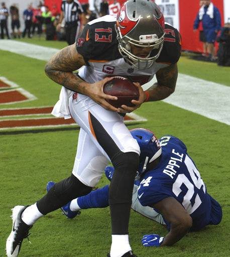 Tampa Bay Buccaneers wide receiver Mike Evans (13) pulls in a 6-yard touchdown reception in front of New York Giants cornerback Eli Apple (24) during the first quarter of an NFL football game Sunday, Oct. 1, 2017, in Tampa, Fla.