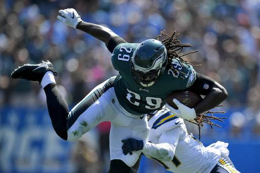 Philadelphia Eagles running back LeGarrette Blount (29) tries to break free from Los Angeles Chargers strong safety Jahleel Addae during the first half of an NFL football game Sunday, Oct. 1, 2017, in Carson, Calif.