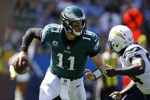Philadelphia Eagles quarterback Carson Wentz scrambles during the first half of an NFL football game against the Los Angeles Chargers Sunday, Oct. 1, 2017, in Carson, Calif.