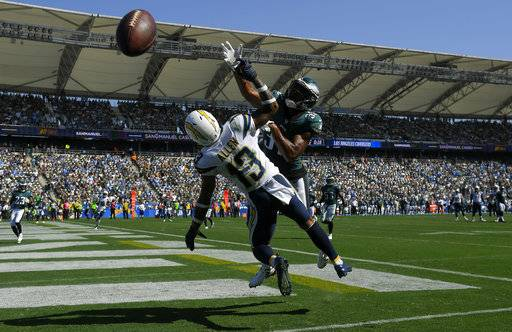 Los Angeles Chargers wide receiver Keenan Allen (13) can't make the catch in the end zone as Philadelphia Eagles cornerback Rasul Douglas defends during the first half of an NFL football game Sunday, Oct. 1, 2017, in Carson, Calif.