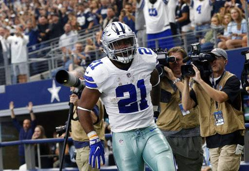 Dallas Cowboys running back Ezekiel Elliott (21) celebrates running the ball for a touchdown against the Los Angeles Rams in the first half of an NFL football game, Sunday, Oct. 1, 2017, in Arlington, Texas.