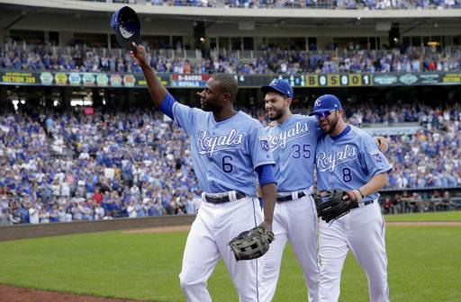 Veteran Kansas City Royals players Lorenzo Cain (6), Eric Hosmer (35) and Mike Moustakas (8) acknowledge the crowd as they come out of a baseball game during the fifth inning against the Arizona Diamondbacks, Sunday, Oct. 1, 2017, in Kansas City, Mo.