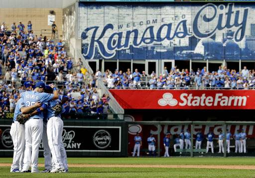 Veteran Kansas City Royals players Eric Hosmer, Lorenzo Cain, Mike Moustakas and Alcides Escobar gather in the infield before coming out of the game during the fifth inning of a baseball game against the Arizona Diamondbacks Sunday, Oct. 1, 2017, in Kansas City, Mo.
