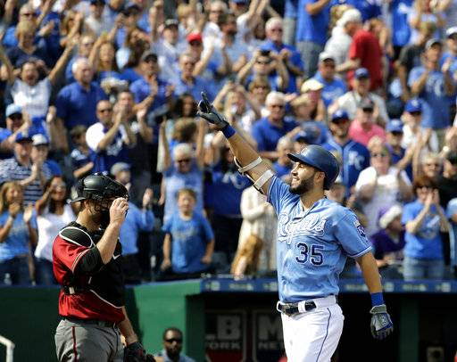 Kansas City Royals' Eric Hosmer celebrates as he crosses the plate after hitting a solo home run during the first inning of a baseball game against the Arizona Diamondbacks Sunday, Oct. 1, 2017, in Kansas City, Mo.