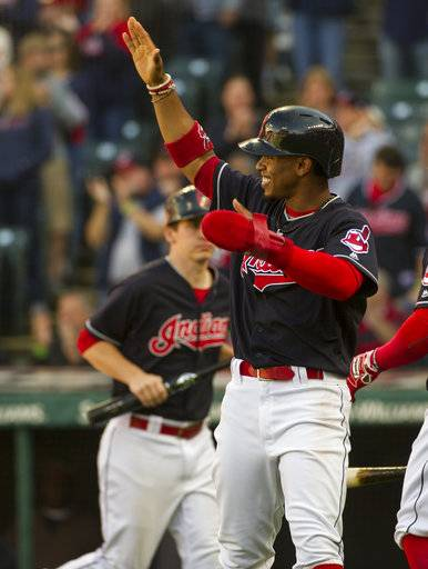 Cleveland Indians' Francisco Lindor celebrates after scoring on a single by Jay Bruce off Chicago White Sox starting pitcher Chris Volstad during the first inning of a baseball game in Cleveland, Sunday, Oct. 1, 2017.
