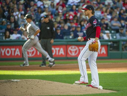 Cleveland Indians starting pitcher Josh Tomlin waits for Chicago White Sox's Rob Brantly to round the bases after hitting a solo home run during the fifth inning of a baseball game in Cleveland, Sunday, Oct. 1, 2017.