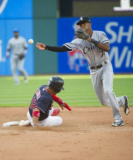 Chicago White Sox's Tim Anderson throws to first base after forcing Cleveland Indians' Francisco Lindor at second base during the seventh inning of a baseball game in Cleveland, Sunday, Oct. 1, 2017. The throw was not in time for a double play.