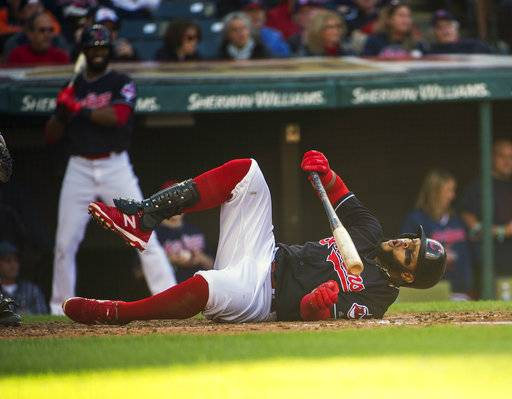 Cleveland Indians' Carlos Santana falls after a foul tip off his leg during the sixth inning of a baseball game against the Chicago White Sox in Cleveland, Sunday, Oct. 1, 2017.