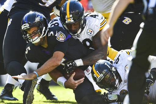 Baltimore Ravens quarterback Joe Flacco (5) is sacked by Pittsburgh Steelers outside linebacker Bud Dupree (48) during the second half of an NFL football game in Baltimore, Sunday, Oct. 1, 2017. The Steelers defeated the Ravens 26-9.