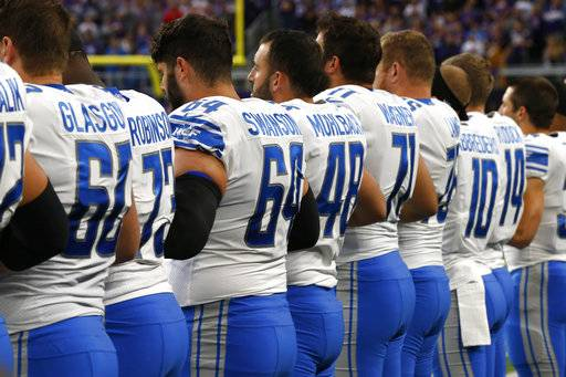 Detroit Lions players lock arms during the playing of the national anthem before an NFL football game against the Minnesota Vikings, Sunday, Oct. 1, 2017, in Minneapolis.