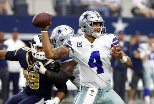 Dallas Cowboys quarterback Dak Prescott (4) throws a pass in the second half of an NFL football game against the Los Angeles Rams on Sunday, Oct. 1, 2017, in Arlington, Texas.