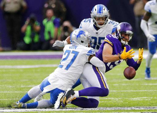 Minnesota Vikings wide receiver Adam Thielen (19) fumbles the ball as he is tackled by Detroit Lions free safety Glover Quin (27) and strong safety Miles Killebrew (35) during the second half of an NFL football game, Sunday, Oct. 1, 2017, in Minneapolis. The Lions won 14-7.