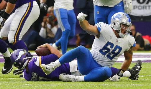 Detroit Lions defensive end Anthony Zettel (69) celebrates after sacking Minnesota Vikings quarterback Case Keenum, left, during the second half of an NFL football game, Sunday, Oct. 1, 2017, in Minneapolis.