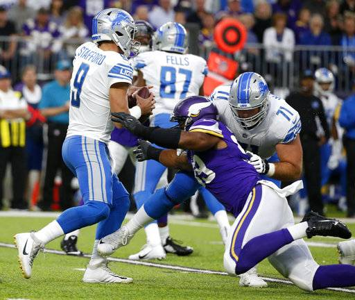 Detroit Lions quarterback Matthew Stafford (9) is sacked by Minnesota Vikings defensive end Danielle Hunter (99) during the first half of an NFL football game, Sunday, Oct. 1, 2017, in Minneapolis.