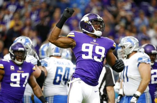 Minnesota Vikings defensive end Danielle Hunter (99) celebrates after sacking Detroit Lions quarterback Matthew Stafford during the first half of an NFL football game, Sunday, Oct. 1, 2017, in Minneapolis.