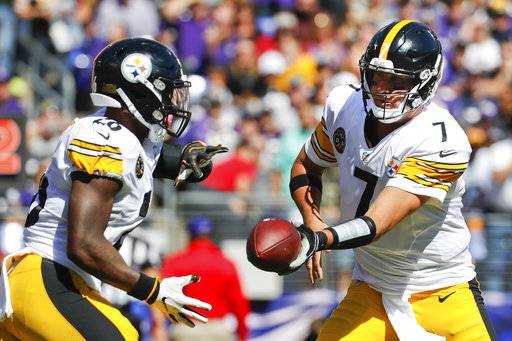Pittsburgh Steelers quarterback Ben Roethlisberger (7) hands off the ball to running back Le'Veon Bell (26) during the first half of an NFL football game against the Baltimore Ravens in Baltimore, Sunday, Oct. 1, 2017.