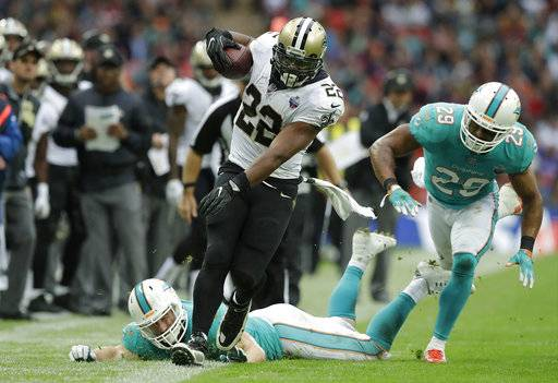 New Orleans Saints running back Mark Ingram (22) runs against the Miami Dolphins during the second half of an NFL football game at Wembley Stadium in London, Sunday Oct. 1, 2017.