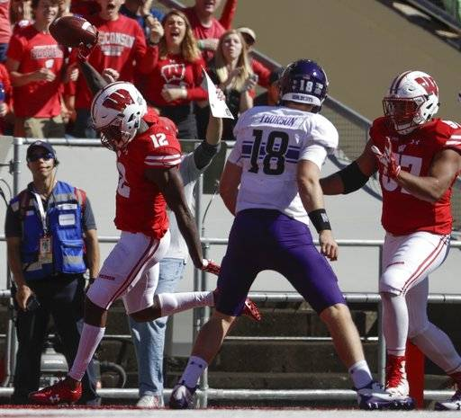 Wisconsin's Natrell Jamerson scores in front of Northwestern's Clayton Thorson (18) after intercepting a pass during the second half of an NCAA college football game Saturday, Sept. 30, 2017, in Madison, Wis. Wisconsin won 33-24.