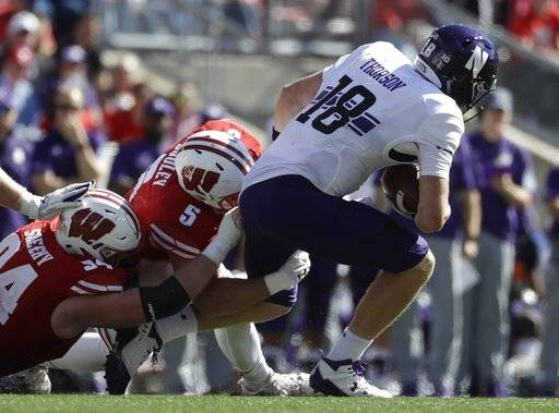 Wisconsin's Chris Orr and Garret Dooley (5) sack Northwestern's Clayton Thorson during the second half of an NCAA college football game Saturday, Sept. 30, 2017, in Madison, Wis. Wisconsin won 33-24.