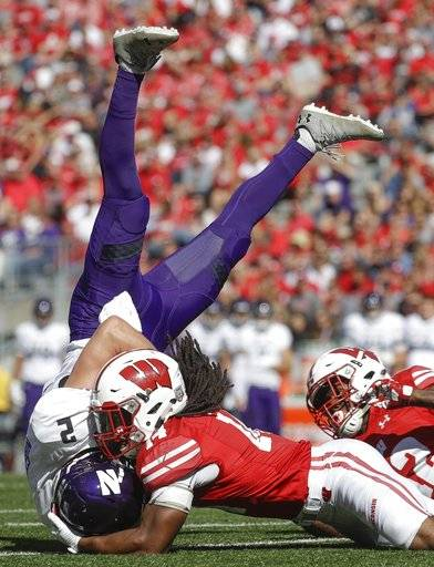 Northwestern's Flynn Nagel is tackled by Wisconsin's D'Cota Dixon after catching a pass during the second half of an NCAA college football game Saturday, Sept. 30, 2017, in Madison, Wis. Wisconsin won 33-24.
