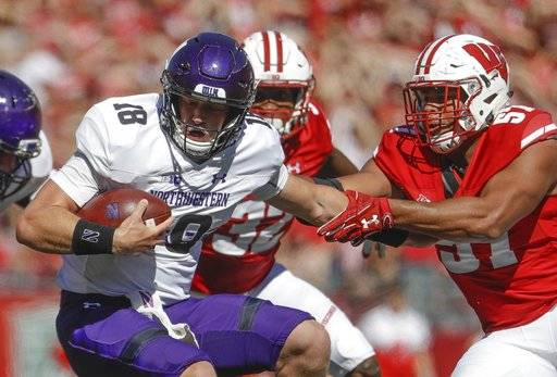 Wisconsin's Alec James sacks Northwestern's Clayton Thorson during the second half of an NCAA college football game Saturday, Sept. 30, 2017, in Madison, Wis. Wisconsin won 33-24.