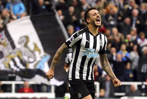Newcastle United's Joselu celebrates scoring his side's first goal of the game against Liverpool during the English Premier League soccer match at St James' Park, Newcastle, England, Sunday, Oct. 1, 2017. (Owen Humphreys/PA via AP)