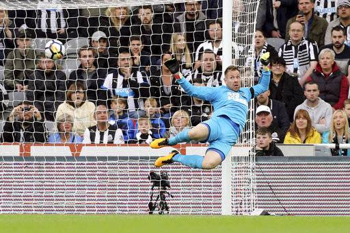 Newcastle United goalkeeper Rob Elliot is beaten by the ball during the English Premier League soccer match at St James' Park, Newcastle, England, Sunday, Oct. 1, 2017. (Owen Humphreys/PA via AP)