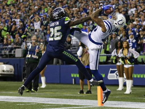Indianapolis Colts wide receiver Donte Moncrief, right, makes a catch for a touchdown against Seattle Seahawks cornerback Shaquill Griffin (26) in the first half of an NFL football game, Sunday, Oct. 1, 2017, in Seattle.