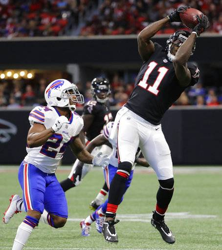 Atlanta Falcons wide receiver Julio Jones (11) makes the catch against Buffalo Bills defensive back Leonard Johnson (24) during the first half of an NFL football game, Sunday, Oct. 1, 2017, in Atlanta.