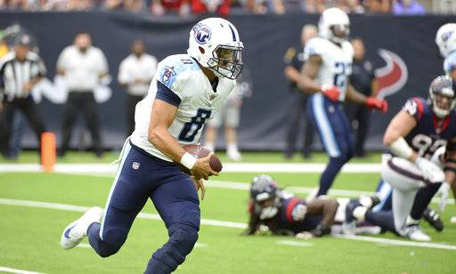Tennessee Titans quarterback Marcus Mariota (8) runs for a touchdown against the Houston Texans during the first half of an NFL football game, Sunday, Oct. 1, 2017, in Houston.