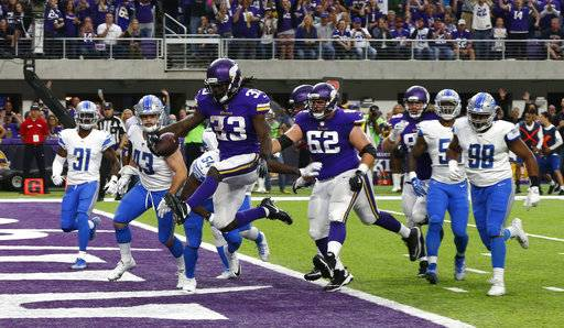Minnesota Vikings running back Dalvin Cook (33) scores on a 5-yard touchdown run during the first half of an NFL football game against the Detroit Lions, Sunday, Oct. 1, 2017, in Minneapolis.