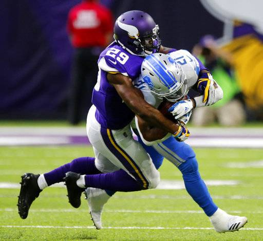 Detroit Lions running back Ameer Abdullah (21) is tackled by Minnesota Vikings cornerback Xavier Rhodes (29) during the first half of an NFL football game, Sunday, Oct. 1, 2017, in Minneapolis.