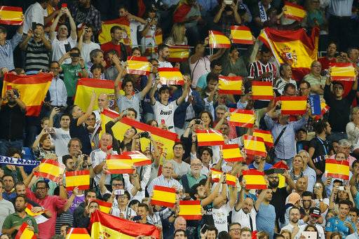Real Madrid fans display Spanish national flags in support of a united Spain against the Catalonian referendum for independence, during a Spanish La Liga soccer match between Real Madrid and Espanyol at the Santiago Bernabeu stadium in Madrid, Spain, Sunday, Oct. 1, 2017.