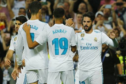Real Madrid's Isco, right, celebrates with team mates after scoring the opening goal during a Spanish La Liga soccer match between Real Madrid and Espanyol at the Santiago Bernabeu stadium in Madrid, Spain, Sunday, Oct. 1, 2017.