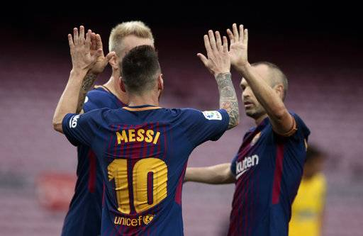 Barcelona's Lionel Messi, center, celebrates his second goal during the Spanish La Liga soccer match between Barcelona and Las Palmas at the Camp Nou stadium in Barcelona, Spain, Sunday, Oct. 1, 2017. Barcelona's Spanish league game against Las Palmas is played without fans amid the controversial referendum on Catalonia's independence.