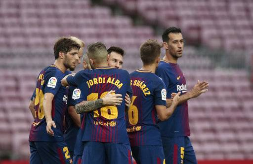 Barcelona's Lionel Messi, center, celebrates with his teammates after scoring his side's second goal during the Spanish La Liga soccer match between Barcelona and Las Palmas at the Camp Nou stadium in Barcelona, Spain, Sunday, Oct. 1, 2017. Barcelona's Spanish league game against Las Palmas is played without fans amid the controversial referendum on Catalonia's independence.