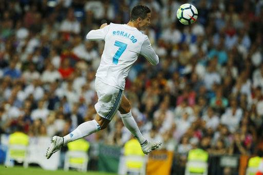 Real Madrid's Cristiano Ronaldo jumps for a high ball during a Spanish La Liga soccer match between Real Madrid and Espanyol at the Santiago Bernabeu stadium in Madrid, Spain, Sunday, Oct. 1, 2017.