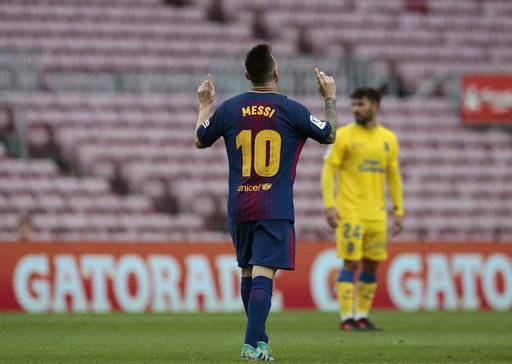 Barcelona's Lionel Messi celebrates his goal during the Spanish La Liga soccer match between Barcelona and Las Palmas at the Camp Nou stadium in Barcelona, Spain, Sunday, Oct. 1, 2017. Barcelona's Spanish league game against Las Palmas is played without fans amid the controversial referendum on Catalonia's independence.