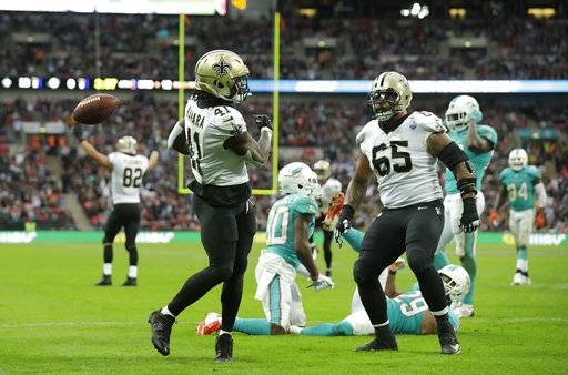 New Orleans Saints running back Alvin Kamara (41) celebrates with offensive guard Senio Kelemete (65) after scoring a touchdown during the second half of an NFL football game against the Miami Dolphins at Wembley Stadium in London, Sunday Oct. 1, 2017.