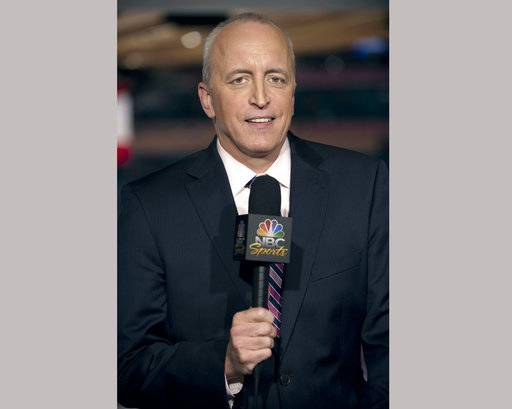 "This April 4, 2011 image released by NBC Universal shows announcer Dave Strader for ""NHL on Versus,"" in New York. Strader died Sunday, Oct. 1, 2017, at his home in Glens Falls, N.Y., after battling bile duct cancer for over a year. He was 62. (Virginia Sherwood/NBC Universal via AP)"