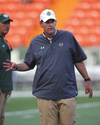 Colorado State head coach Mike Bobo is seen on the field before the NCAA college football game against Hawaii, Saturday, Sept. 30, 2017, in Honolulu.