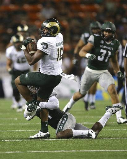Colorado State tight end Cameron Butler (16) gets tackled by Hawaii defensive back Daniel Lewis Jr. (4) during the second quarter of the NCAA college football game, Saturday, Sept. 30, 2017, in Honolulu.