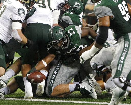 Hawaii running back Diocemy Saint Juste (22) sneaks the ball into the end zone during the second quarter of the NCAA college football game against Colorado St, Saturday, Sept. 30, 2017, in Honolulu.