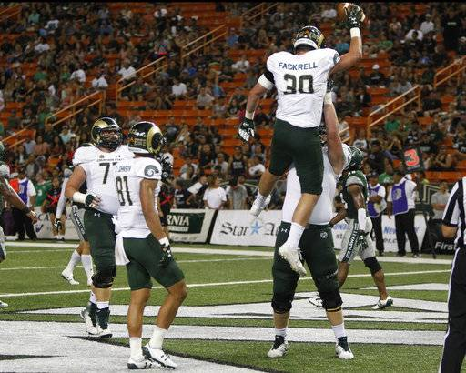 Colorado State tight end Dalton Fackrell (30) reacts with teammates after he made a touchdown during the second quarter of the NCAA college football game against Hawaii, Saturday, Sept. 30, 2017, in Honolulu.