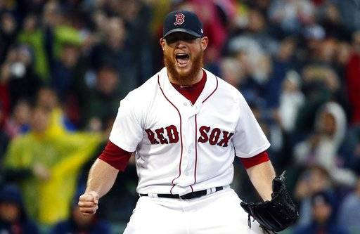 Boston Red Sox's Craig Kimbrel reacts after striking out Houston Astros' George Springer to clinch the American League East Division championship in a baseball game in Boston, Saturday, Sept. 30, 2017.